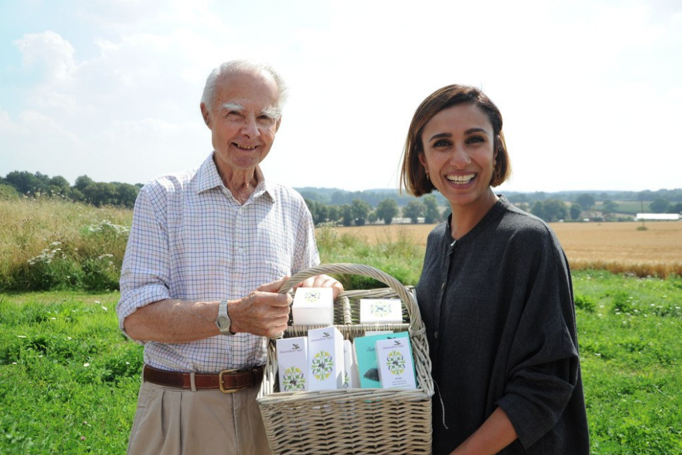 BBC Countryfile presenter Anita Rani holds a basket full of natural beauty products.