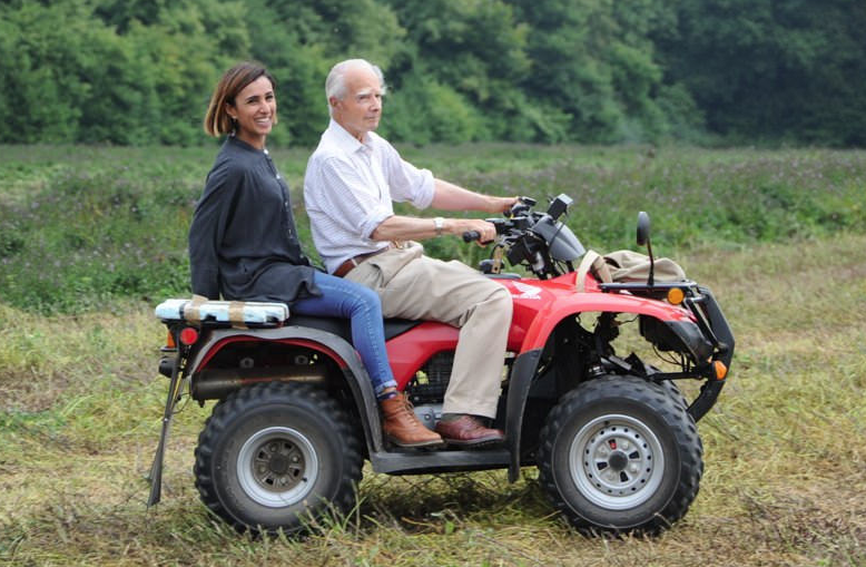 Sir Michael shows Anita the farm where our famous Peppermint Oil is made.